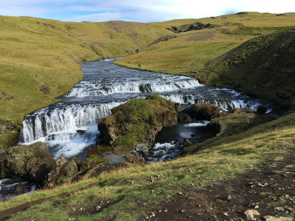 Hiking trail and falls in behind Skógafoss